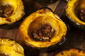 stock photo of acorn  - Homemade Roasted Acorn Squash with Brown Sugar and Pecans - JPG