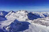 pic of mountain chain  - Mountain peaks chain in Jungfrau region helicopter view in winter - JPG