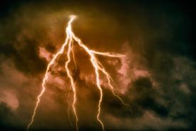 stock photo of lightning-rod  - A dark cloudy sky with lightning  - JPG