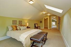 pic of master bedroom  - Spacious light mint bedroom interior with vaulted ceiling skylight - JPG