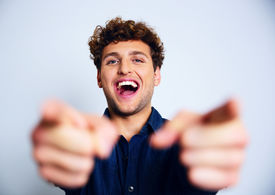foto of prank  - Portrait of a laughing man pointing at you - JPG