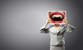foto of big lips  - Unrecognizable businesswoman holding big photo with lips - JPG
