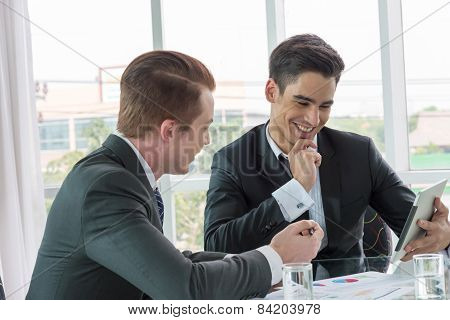 Two Businessman Dicussing Business In Office