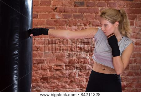 Girl Training With Punch Bag