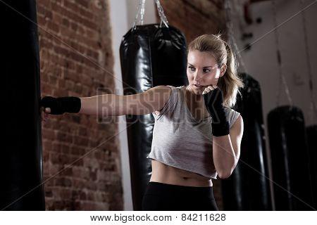 Girl Training Kick Boxing
