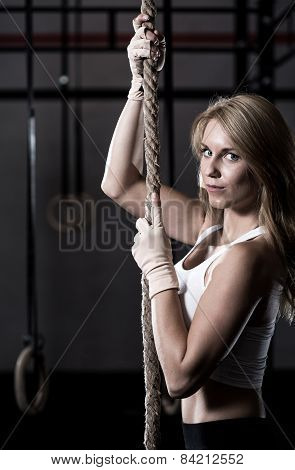 Girl During Rope Climbing Exercise