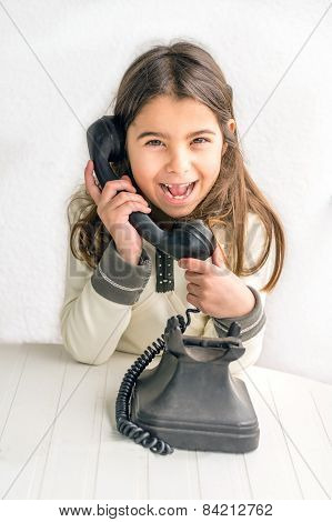 Seven Year Old Girl With Old Vintage Phone Before White Background