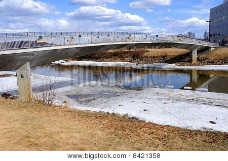 Arctic River with Bridge during Spring Breakup