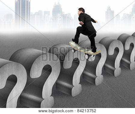Businessman Skating On Money Skateboard Across Concrete Question Mark