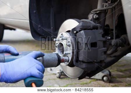 Car Wheel Changed By Mechanic