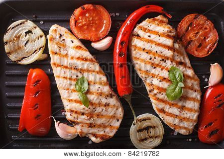 Chicken Breast With Vegetables In A Skillet Grill Top View