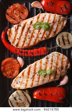 Chicken Breast With Vegetables In A Pan Grill Top View Vertical