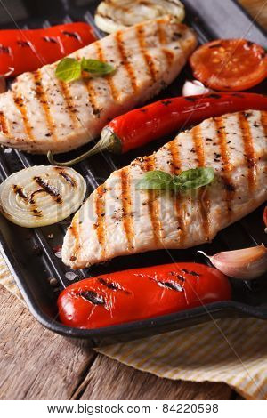 Hot Chicken Breast With Vegetables In A Skillet Grill Vertical