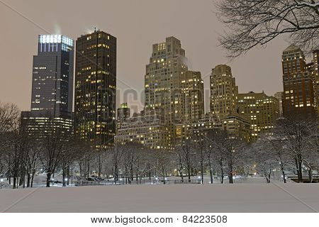 Manhattan skyline in evening after snowstorm, viewed from Central Park