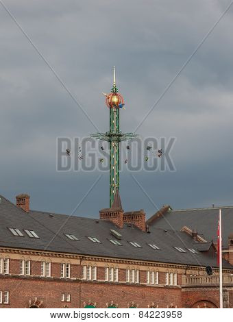 The Fairground Fun Fair In Tivoli Gardens. Copenhagen, Denmark, On A Gray Sky
