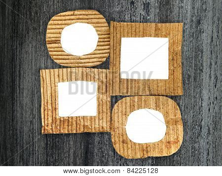 Group Of Blank Cardboard Frames On Grunge Painted Background