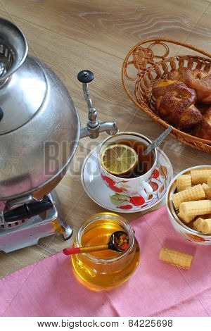 Tea From A Samovar, With A Lemon, Honey, Rolls And Wafers