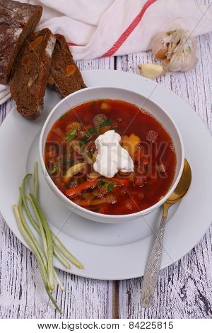 Borsch With Vegetables And A String Bean Submitted With Sour Cream, Garlic, Bread And A Fresh Ramson