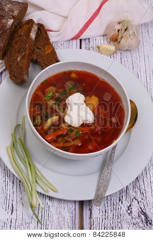 Vegetable Borsch With A String Bean Submitted With Sour Cream, Garlic, Bread And A Ramson, A Still-l