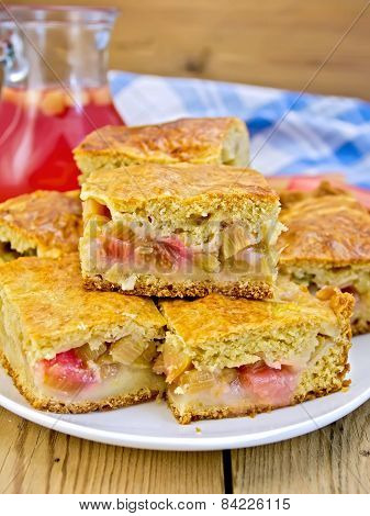 Pie rhubarb in plate and juice on board