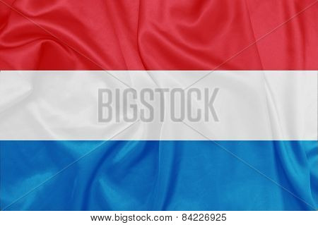 Luxembourg - Waving national flag on silk texture