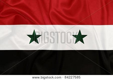 Syria - Waving national flag on silk texture