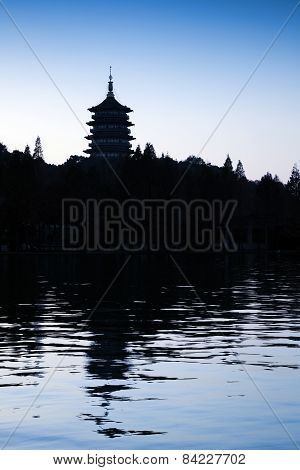 Traditional Chinese Pagoda On Dark Blue Evening Sky