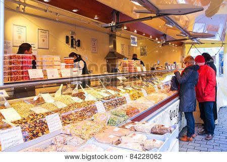 People Buy Nuts And Sweets On The Market  In  Dutch Town Den Bosch.