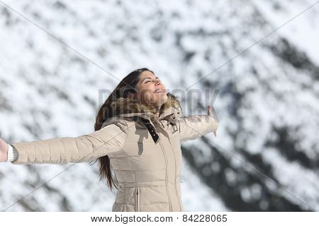 Woman Breathing Fresh Air In The Mountain In Winter