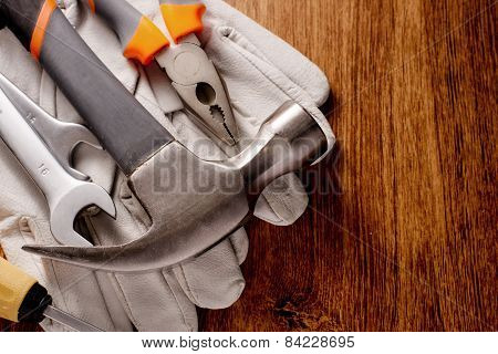 Hand Tools On Gloves On A Table With Copy Space