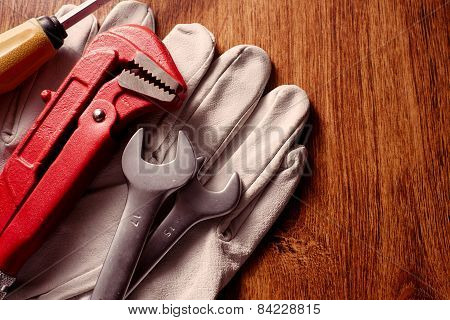 Tools And Gloves On Table With Copy Space On Right