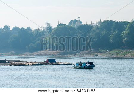 Myanmar boat with logs
