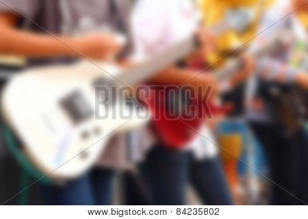 Blurred Image Of Guitarists Playing Guitar.