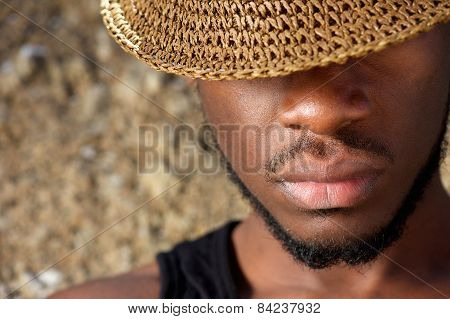 Young Man With Hat Covering Face