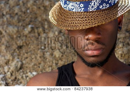 Young African American Man With Hat Covering Face