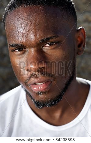 Handsome Young Black Man With Sweat Dripping Down Face