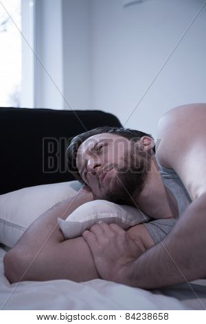 Awake Man Lying In Bed