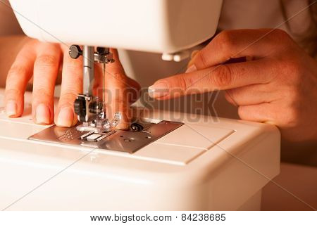 Sewing Process - Women Taylor's  Hands Behind Her Sewing Machine
