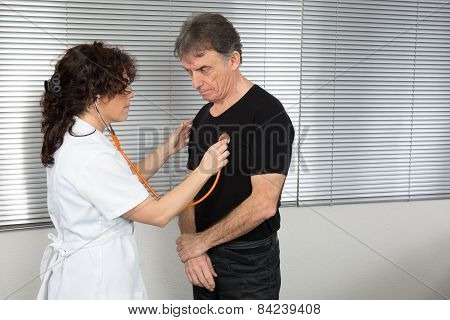 Woman doctor with her patient