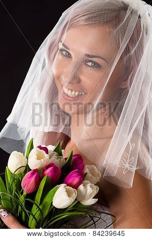 portrait of happy bride with a bouquet of tulips