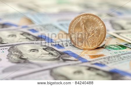 One American Dollar Coin Over Banknotes Close Up