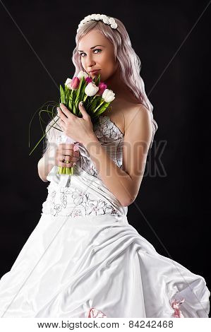 beautiful bride with a wedding bouquet of tulips