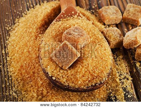 Brown Cane Sugar On  A Old Wooden Board