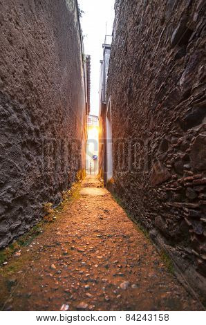 narrow passage between two stone walls