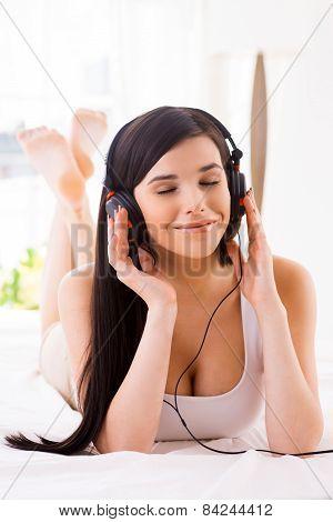 Enjoying Music In Bed.