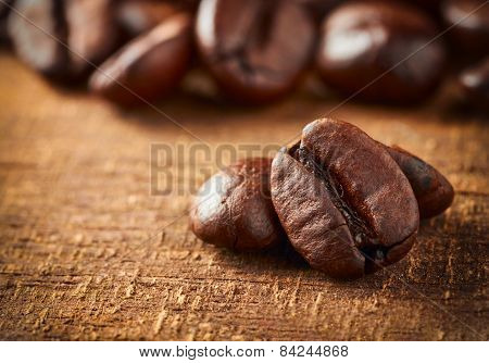 Coffee Bean On Macro Ground Coffee Background