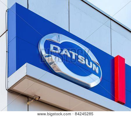 Datsun Dealership Sign Against Blue Sky