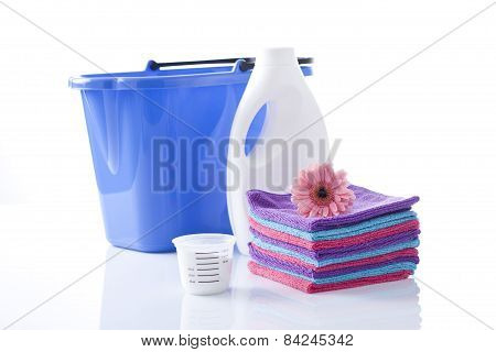 towels and laundry detergent isolated on white