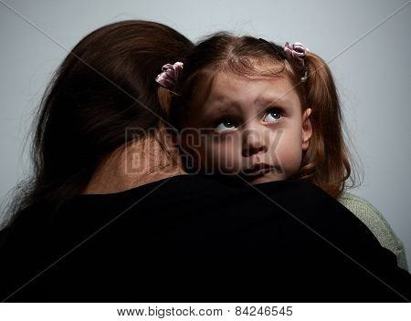 Thinking Sad Daughter Embracing Her Mother And Looking Up