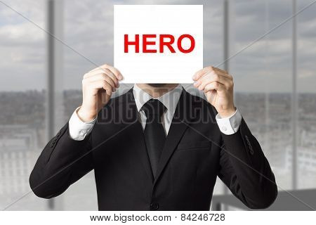 Businessman Hiding Face Behind Sign Hero